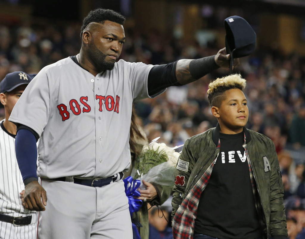David Ortiz tips his cap to the crowd before Thursday's game at New York. D'Angelo Ortiz, right, stands beside his father. Associated PressKathy Willens