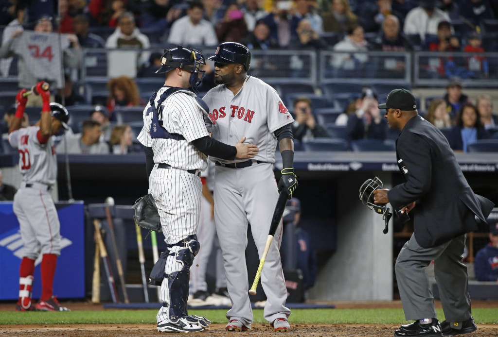 David Ortiz has a conversation with Yankees catcher Brian McCann during the second inning. Associated Press/Kathy Willens