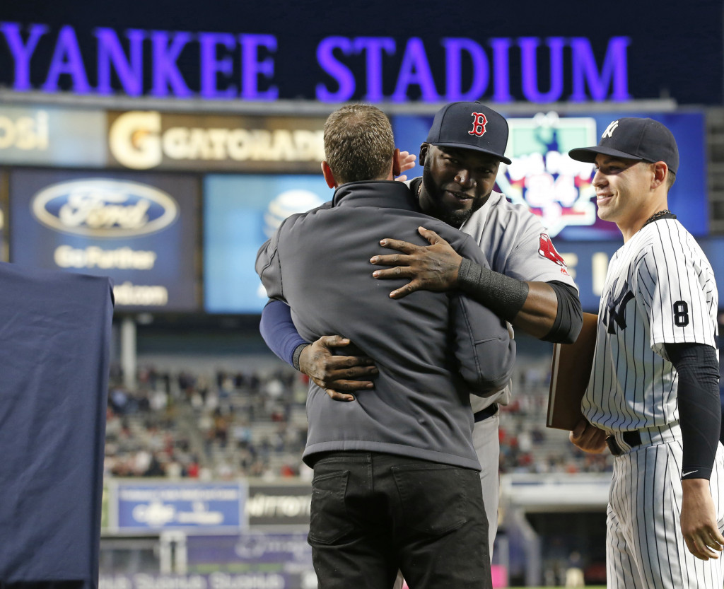 David Ortiz embraces Yankees' broadcaster and former pitcher David Cone. Associated Press/Kathy Willens