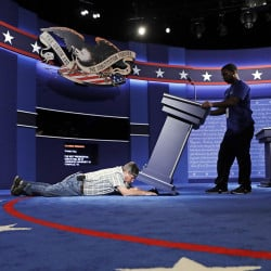 Technicians set up the stage for the presidential debate between Democratic presidential candidate Hillary Clinton and Republican presidential candidate Donald Trump at Hofstra University Sunday,Patrick Semansky