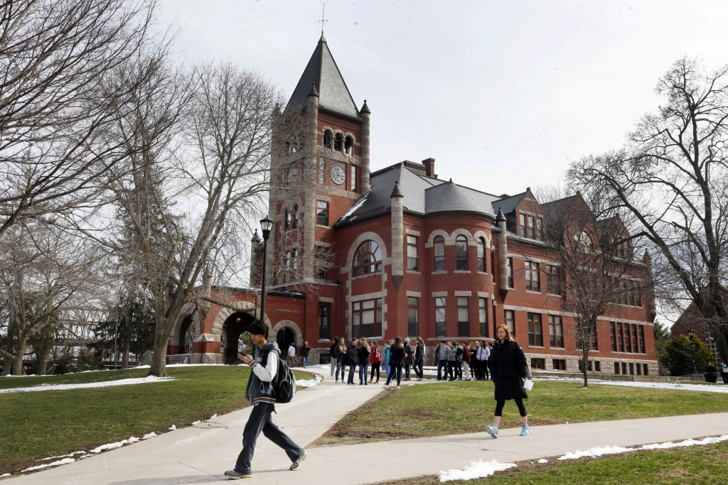 Students walk past Thompson Hall at the University of New Hampshire in Durham in April 2016.