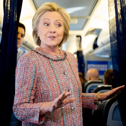 Democratic presidential candidate Hillary Clinton speaks to members of the media on her campaign plane Thursday before traveling to Greensboro, N.C., for a rally. Andrew Harnik/Associated Press