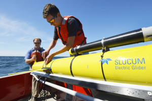 Woods Hole Oceanographic Institution engineers Sean Whelan, left, and Patrick Deane prepare to release a Slocum glider into the waters south of Martha's Vineyard, Mass. Ken Kostel/Woods Hole Oceanographic Institution via AP