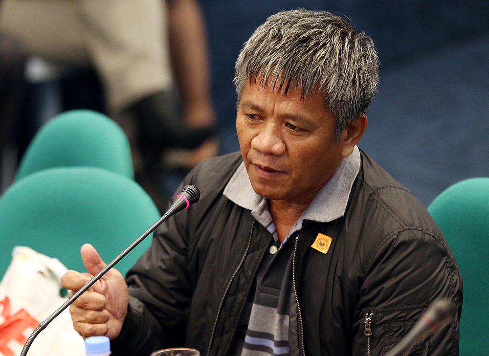 Former Filipino militiaman Edgar Matobato testifies before the Philippine Senate on Thursday. Matobato said that President Rodrigo Duterte, when he was still a city mayor, ordered him and other members of a squad to kill criminals and opponents in gangland-style assaults. <em>Aaron Favila/Associated Press</em>