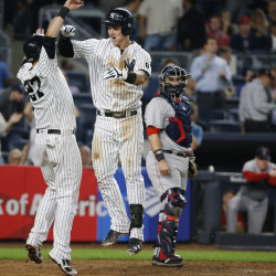 New York's Austin Romine, left, celebrates with Tyler Austin after scoring on Austin's seventh-inning, two-run home run off Red Sox starting pitcher David Price.   Associated Press/Kathy Willens