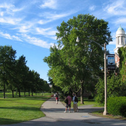 Students walk on the mall near Stevens Hall at the University of Maine in Orono, the flagship campus of the state university system. Photo by Night Three via Wikipedia