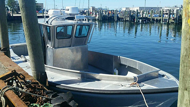 The 31-foot aluminum craft that Nathan and Linda Carman were aboard when they left a Rhode Island marina to go on a fishing trip. <em>Photo courtesy of U.S. Coast Guard</em>