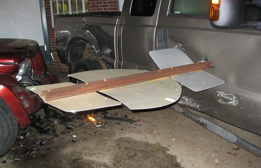 A road sign protrudes from the side of a pickup truck after a crash at Reed's. <em>Photo courtesy of Yarmouth Police Department</em>