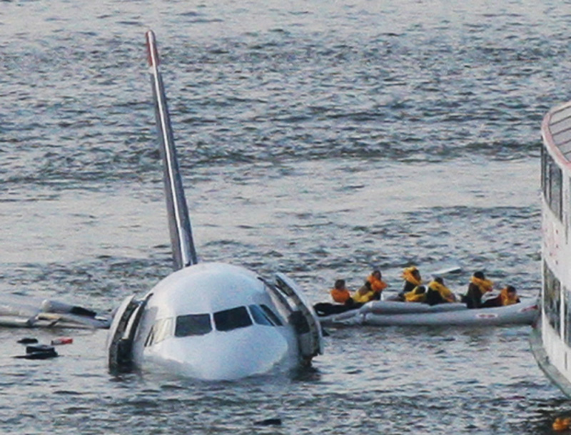 In this 2009 file photo, passengers in an inflatable raft move away from an Airbus 320 US Airways aircraft that went gone down in the Hudson River in New York.