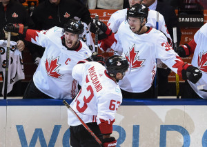 Canada's Brad Marchand, 63, celebrates with Sidney, 87, and Logan Couture (39) after scoring against Europe during the third period of Game 2 of the World Cup of Hockey finals, in Toronto on Thursday. Associated Press/Nathan Denette, The Canadian Press
