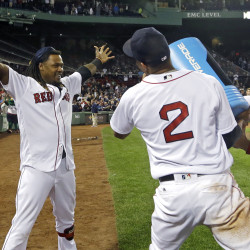 Boston Red Sox's Hanley Ramirez gets ready to be doused by teammates after he hit a three-run walk-off home run against the New York Yankees in a baseball game at Fenway Park, Thursday, Sept. 15, 2016, in Boston. The Red Sox won 7-5. (AP Photo/Elise Amendola)