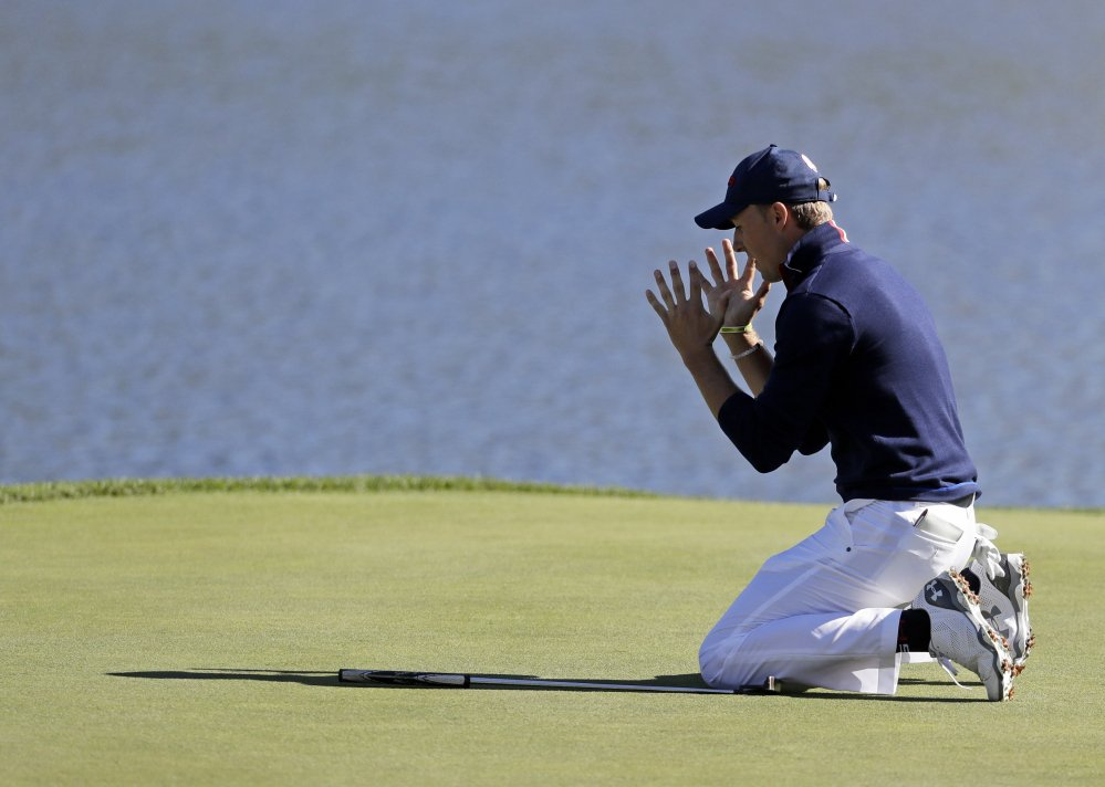 Jordan Spieth of the United States reacts after missing a long putt on the 17th hole during the Ryder Cup golf tournament on Saturday at Hazeltine National Golf Club in Chaska, Minn.