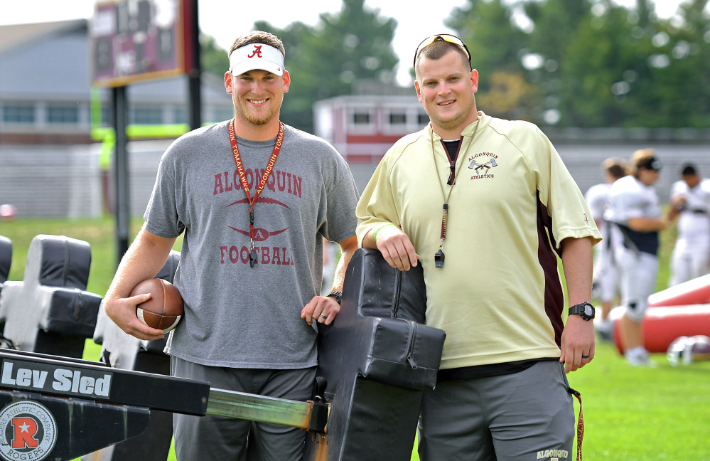 Taylor Allen, left, works as a tight ends coach, and his brother Mark Allen is the defensive coordinator at Algonquin Regional High School in Massachusetts. They are sons of late Holy Cross football coach Dan Allen.