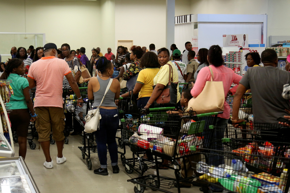 Jamaicans flock to the supermarkets to take care of last-minute shopping pending the arrival of Hurricane Matthew in Kingston, Jamaica, on Friday.