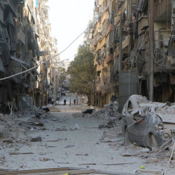 Airstrikes heavily damaged buildings in Aleppo, Syria, on Saturday as Syrian government forces captured the strategic Um al-Shuqeef hill on the northern edge of the city.