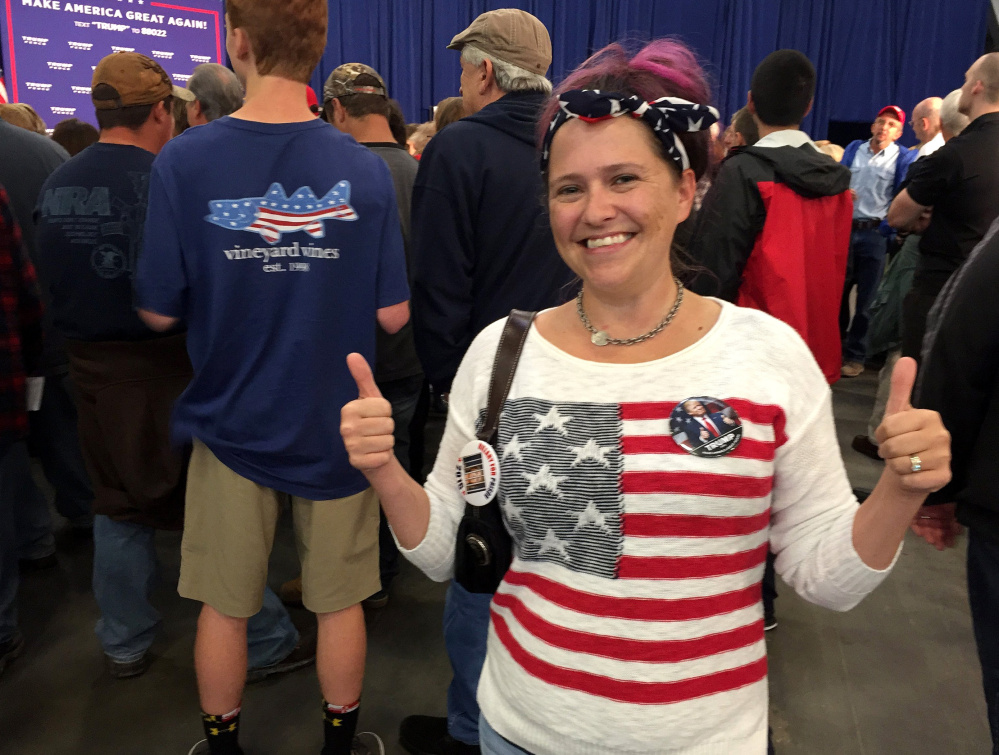 Kelly Hammer signals her support for Donald Trump at a Mike Pence rally in York, Pa.