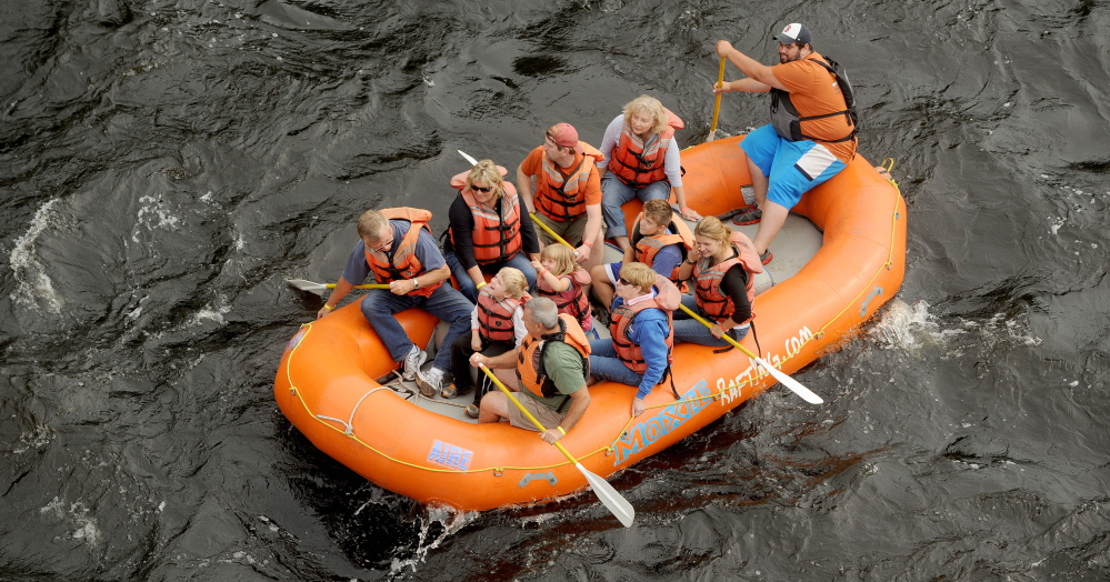 A raft carries whitewater enthusiasts on a free float trip down the Kennebec River during the annual River Festival in Skowhegan in 2014. A proposal for a whitewater park in Skowhegan could bring many more rafts and kayaks down the river and generate about $6 million in revenue and 43 new jobs in its first year of operation, an economic impact study says.