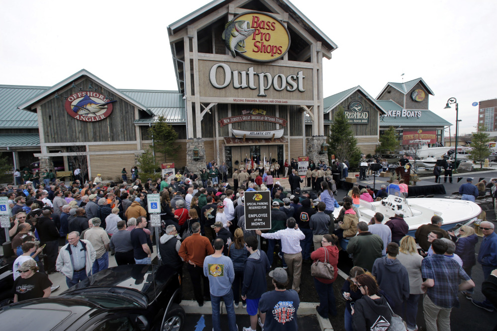 A large crowd of people line up as they wait for the grand opening of Bass Pro Shops Outpost store in Atlantic City, N.J.