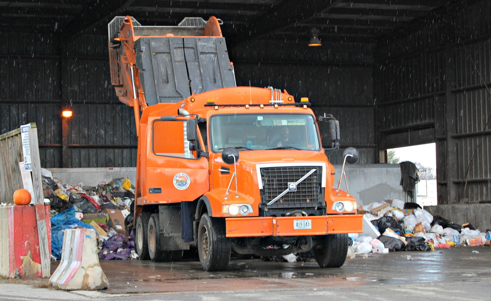 Garbage is emptied at the Oakland transfer station, where trash later goes to the Penobscot Energy Recovery Corp. in Orrington, but in 2018 it will go to a new waste-to-energy Fiberight plant in Hampden.