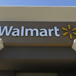 A Wal-Mart store is open for business in San Jose, Calif. Wal-Mart said Thursday it plans to slow new store openings as it looks to pour more money into its online efforts, technology and store remodels.