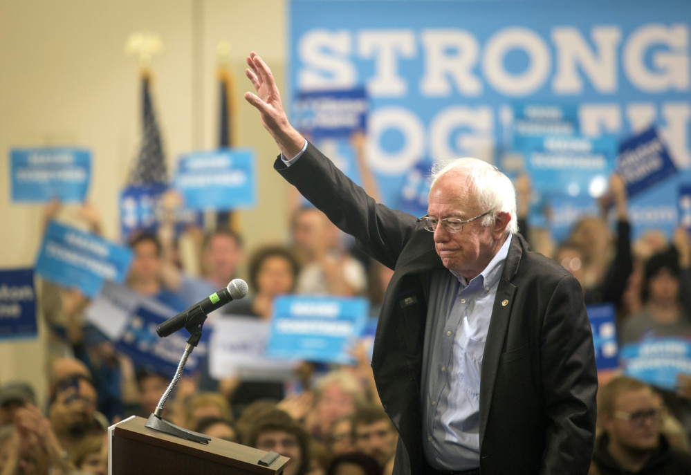 Sen. Bernie Sanders waves after speaking at the Cross Insurance Center on Friday. Sanders urged 2nd District voters to cast their ballots for Hillary Clinton.