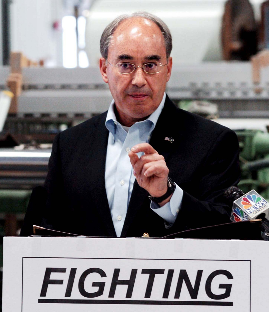U.S. Rep. Bruce Poliquin, R-2nd District, makes a point about fair trade Aug. 30 at Auburn Manufacturing.