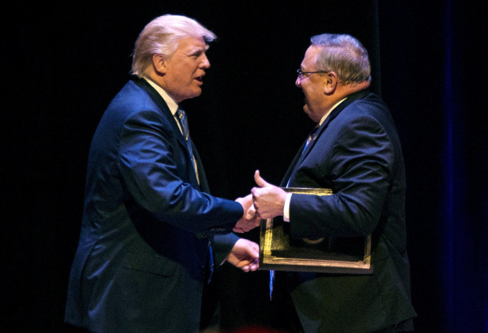 Gov. Paul LePage welcomes Donald Trump to the stage at an Aug. 4, 2016 campaign rally in Portland.