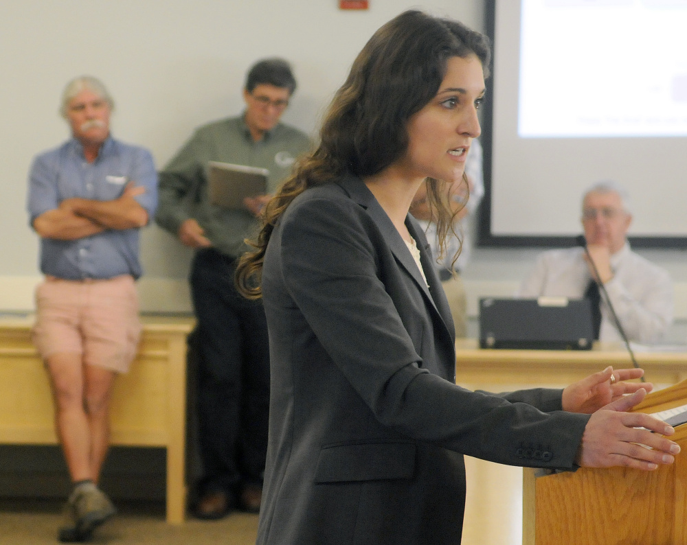 Conservation Law Foundation attorney Emily Green makes a point about proposed rule changes for small-scale solar panels during a hearing Monday at the Maine Public Utilities Commission in Hallowell.