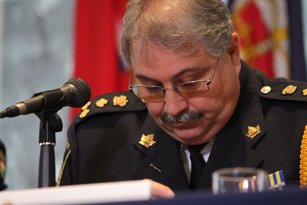 Woodstock Police Chief William Renton announces charges in eight nursing-home deaths on Tuesday.