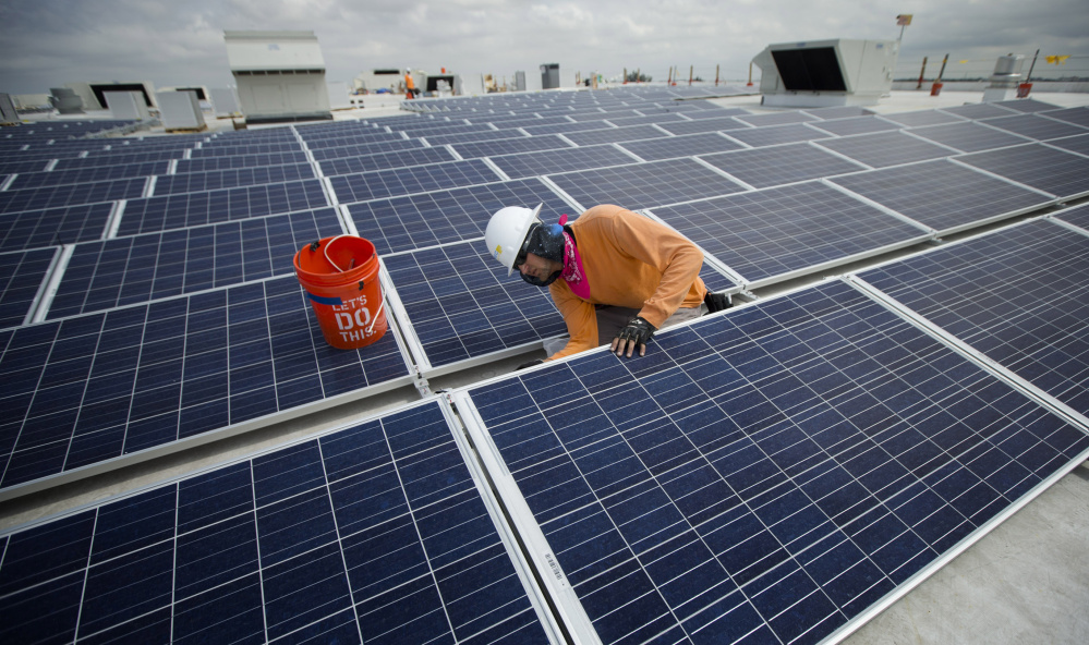 The International Energy Agency says renewable energy projects – like this 178,000-square-foot solar array being installed in Miami – surpassed all other sources of new electricity worldwide last year.