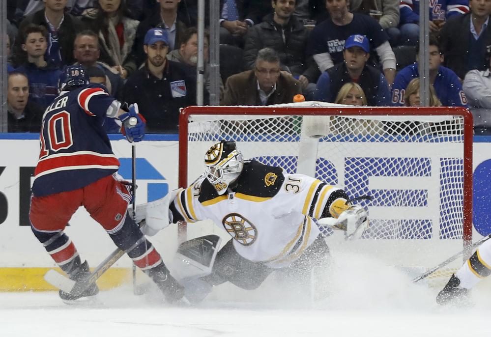 Bruins goalie Zane McIntyre makes a save on a shot by New York's J.T. Miller in the first period Wednesday night in New York.