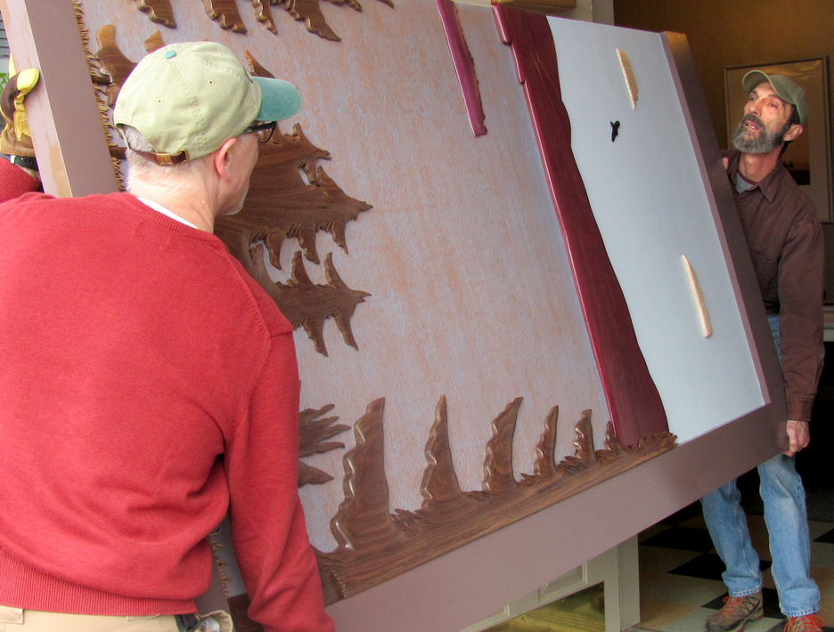 Artist Vincent Richel, right, and volunteer Jeff Zapolsky, left, carry one half of the functional art barn-doors that Richel created for the New Lobby Gallery at the RFA Lakeside Theater. The doors were commissioned by the Rangeley Friends of the Arts and provided for by generous donations.