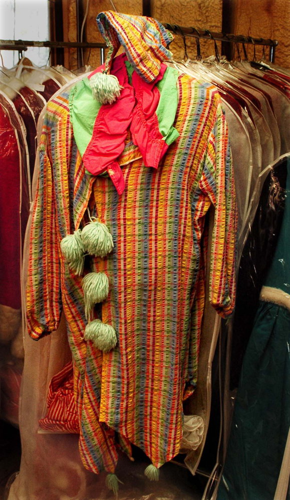 A clown costume hangs on a rack at Are You Ready To Party company in Waterville.