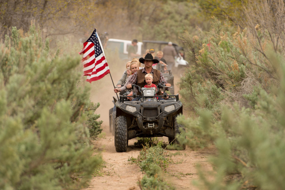 Ryan Bundy rides an ATV into Recapture Canyon north of Blanding, Utah, in May 2014, in a protest against what demonstrators call the federal government's overreaching control of public lands. He was cleared of federal charges in connection with a standoff in Oregon and still faces trial in Nevada.
