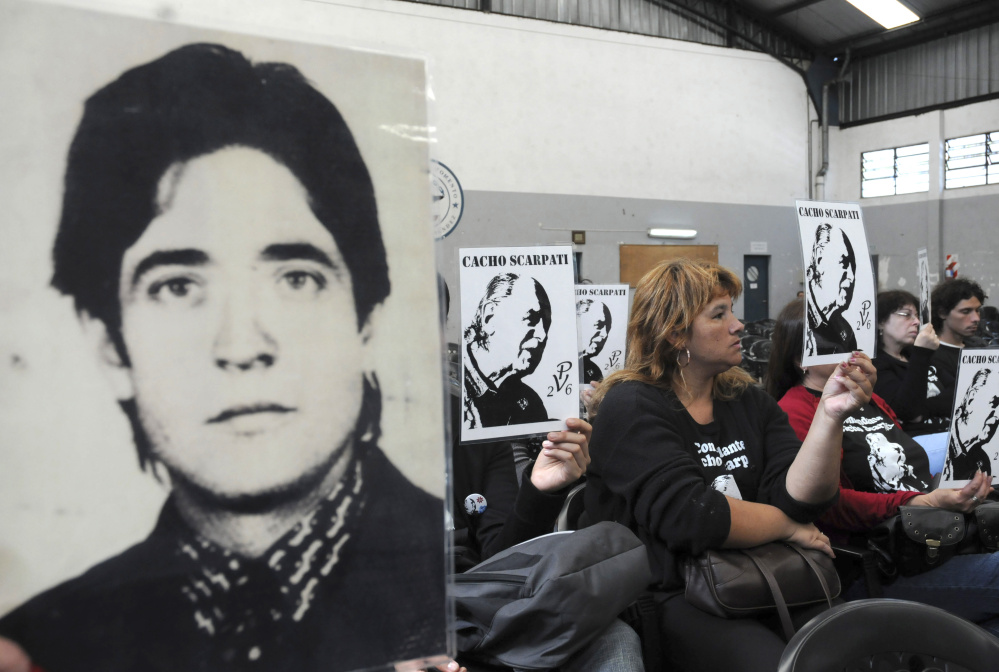 Above, activists hold portraits of missing people during the trial of Argentina's last de facto president, Gen. Reynaldo Bignone, and seven more officers accused of human rights abuses at a courthouse in Buenos Aires on Nov. 4, 2009.  At left, Pope Francis at a meeting with the Argentine Episcopal Conference at the Vatican on Oct. 17. Associated Press photos