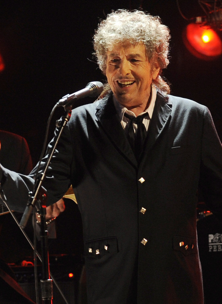 """Bob Dylan, who won the 2016 Nobel Prize for literature on Oct. 13, says he """"absolutely"""" wants to attend the award ceremony in December."""