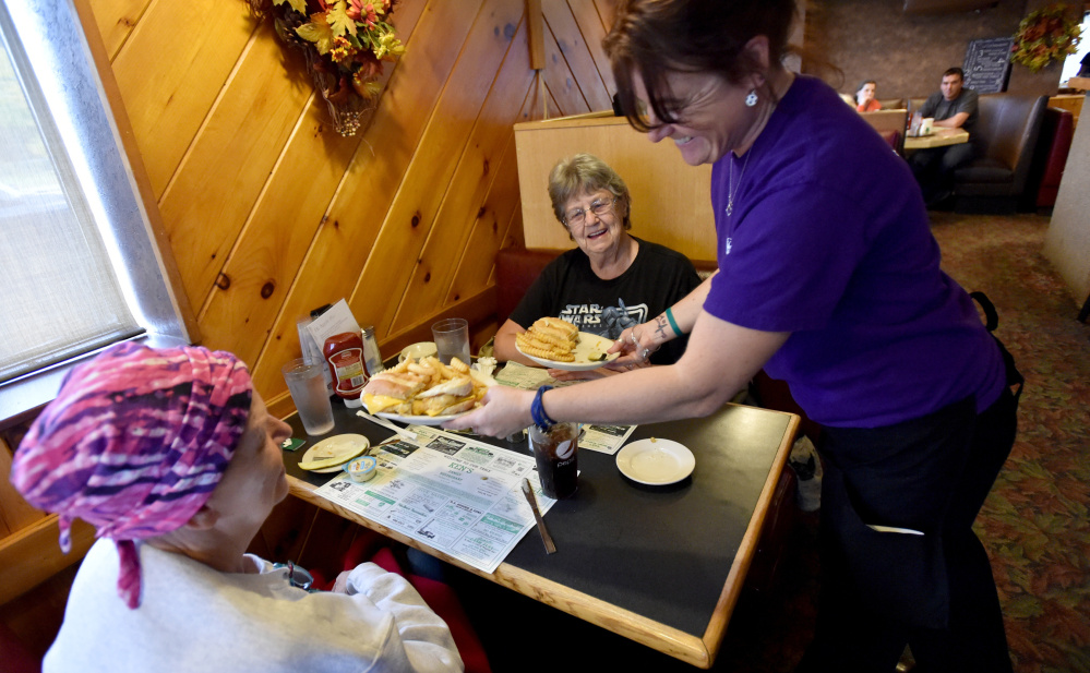 Tammie Webber delivers hot food to Janice Beane, left, and her mother, Orlene Beane, both of Bingham, at Ken's Family Diner in Skowhegan.