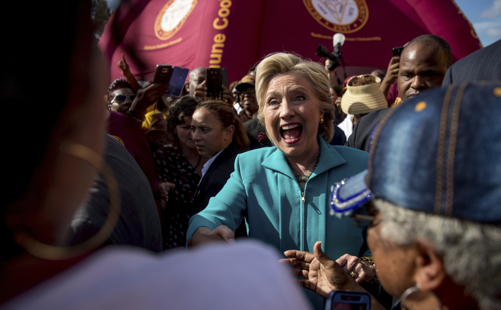Democratic presidential candidate Hillary Clinton greets people at a homecoming tailgate party for Bethune-Cookman in Daytona Beach, Fla., on Saturday.