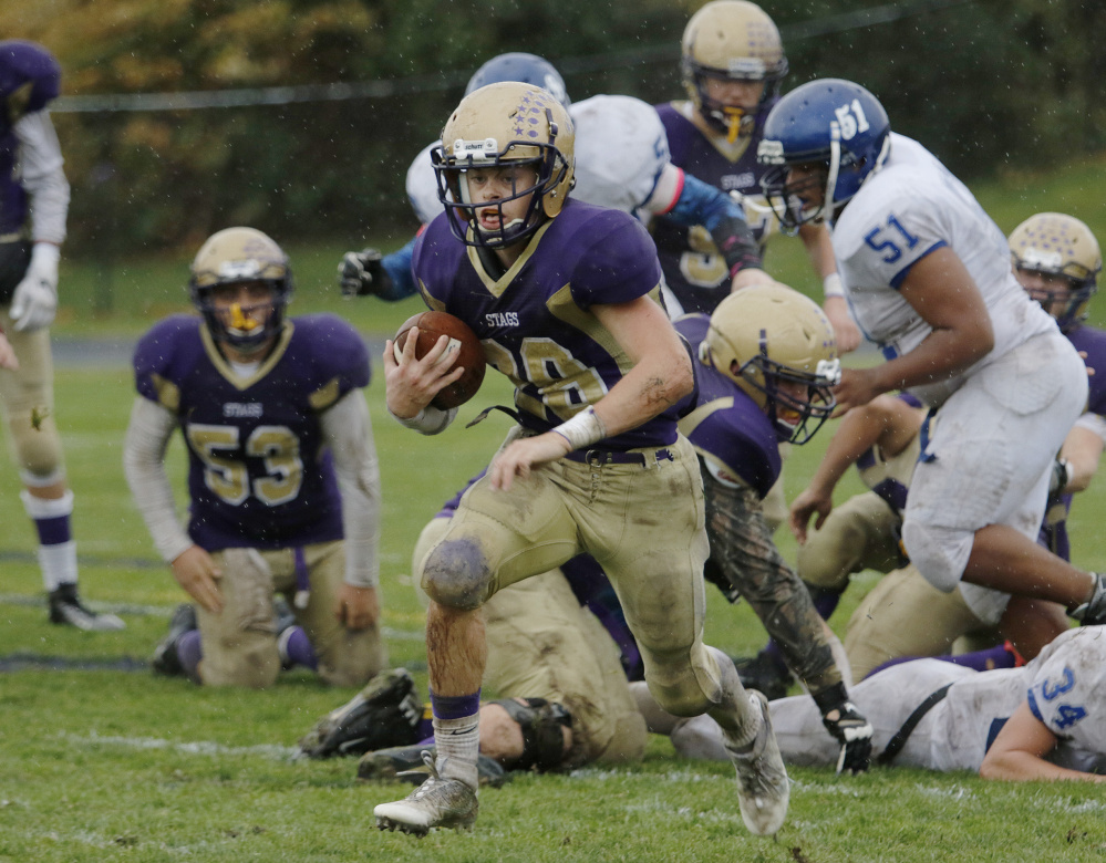 Max Coffin of Cheverus finds some running room beyond the line of scrimmage. Cheverus will travel to Windham for a regional semifinal next weekend.