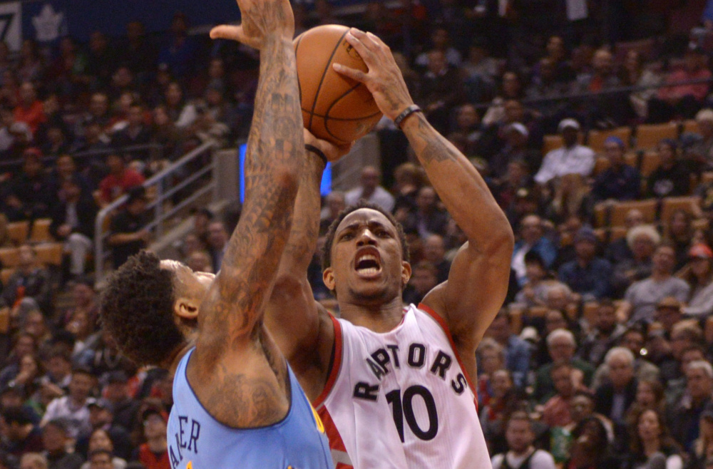 Toronto's DeMar DeRozan shoots over Denver's Wilson Chandler during the first half of the Raptors' 105-102 win Monday night at Toronto. DeRozan finished with 33 points, his third straight game scoring over 30.