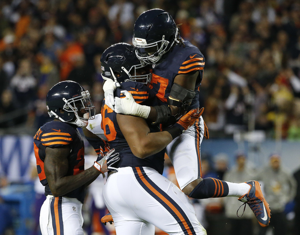 Chicago defensive end Akiem Hicks, center, celebrates a sack with Sherrick McManis, right, during the Bears' 20-10 win Monday night over the Vikings.