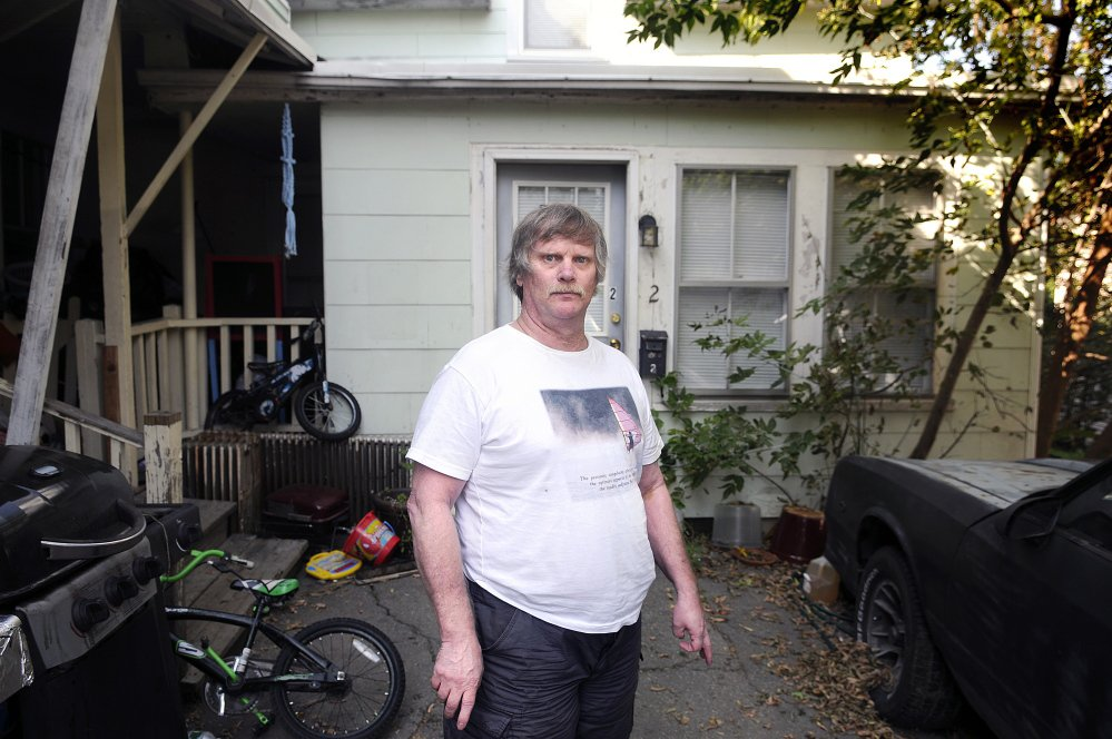 James Pinkham stands outside his apartment at 9 Waldo St. in Augusta in September.