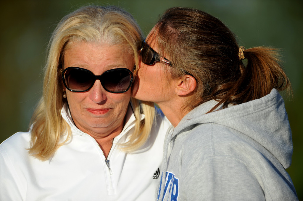 Paula Doughty, left, head coach of the Skowhegan Area High School field hockey team, becomes emotional as she receives a kiss following her 500th victory as head coach.       Michael G. Seamans/Morning Sentinel