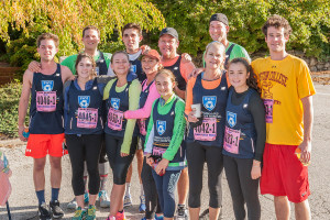 Two of John and Josephine Marrs' children, Bill Marr and Abby Psyhogeos, and four grandchildren – Matthew, Anna and Charlie Marr and Mary Psyhogeos – pose with friends after running in last year's Maine Marathon to raise money for the Alzeimer's fund launched last year by John and Josephine Marr of Falmouth. Photo by Bob Cunningham