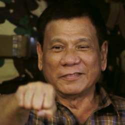 Philippine President Rodrigo Duterte gestures with a fist bump during a visit to an army camp on Aug. 25, 2016. (AP Photo/Bullit Marquez, File)