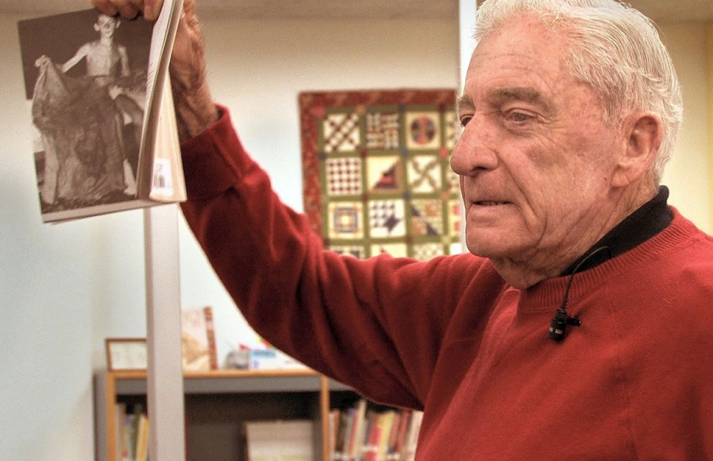 "Donn Fendler holds a copy of his book ""Lost on a Mountain in Maine."" He  frequently visited schools and libraries to talk about his experience and read from his book. Contributed photo"
