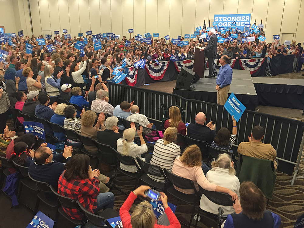 Sen. Bernie Sanders addresses a crowd of supporters on behalf of Hillary Clinton's presidential campaign at the Cross Insurance Center in Bangor on Friday.<em>Brianna Soukup</em>