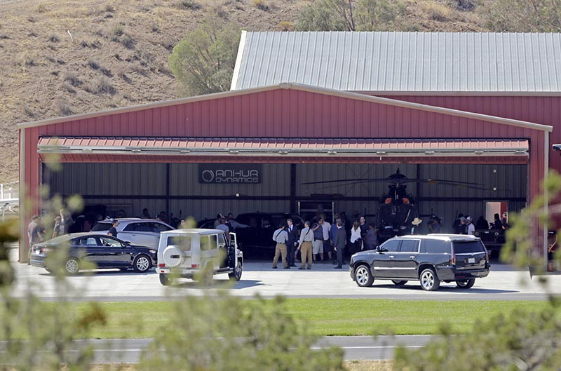 Members of a film crew gather at Agua Dulce Airpark in Agua Dulce, Calif., where stuntman Steve de Castro was injured on July 6.