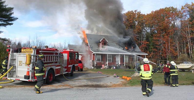Firefighters battle a blaze Sunday at 18 Henderson Drive in Buxton.  Photo courtesy Dan Grover