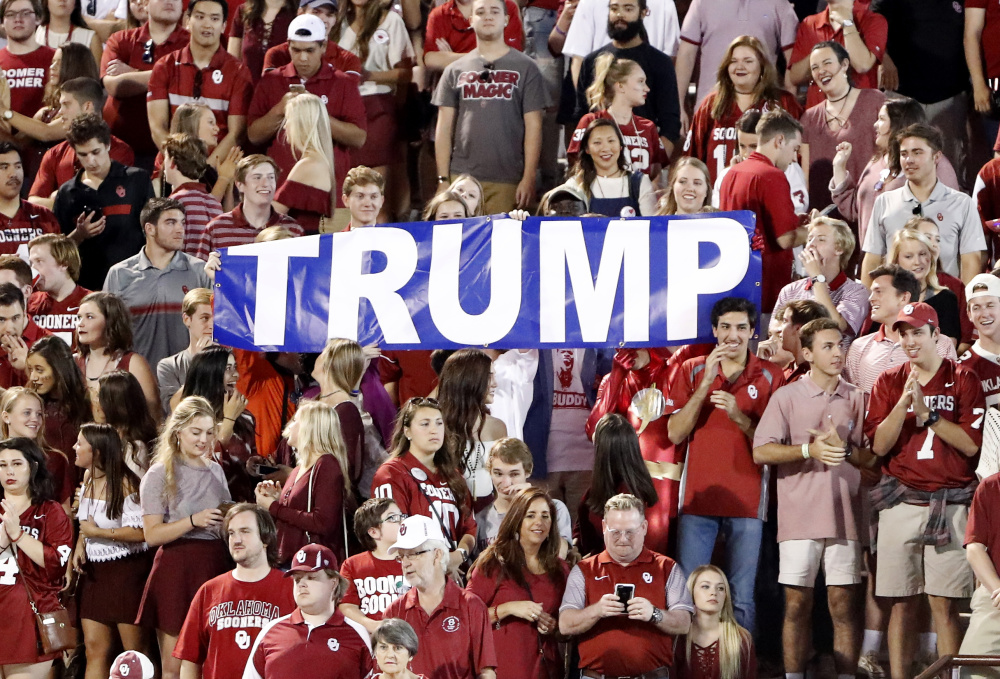 Donald Trump, whose celebrity is important to his businesses, tries to protect his name by buying Web domains that could be used to insult him, such as trumpmustgo.com. But these Oklahoma football fans are on his side.